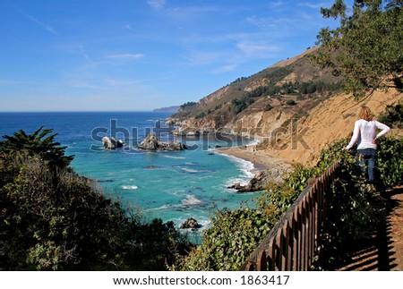 Lady enjoying the beauty of California Coast at Big Sur - stock photo