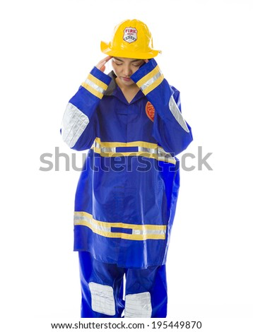 Lady firefighter suffering from headache - stock photo