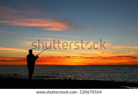 Lady Fishing on Beach at Sunset - Silhouette