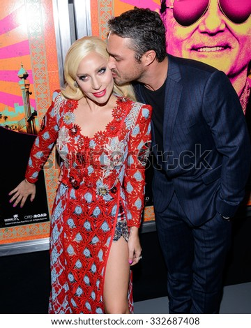 "Lady Gaga and Taylor Kinney arrive at the premiere of ""Rock the Kasbah"" in New York, New York on October 19th 2015 - stock photo"
