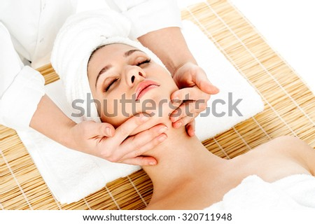 Lady getting face massage at day spa - stock photo