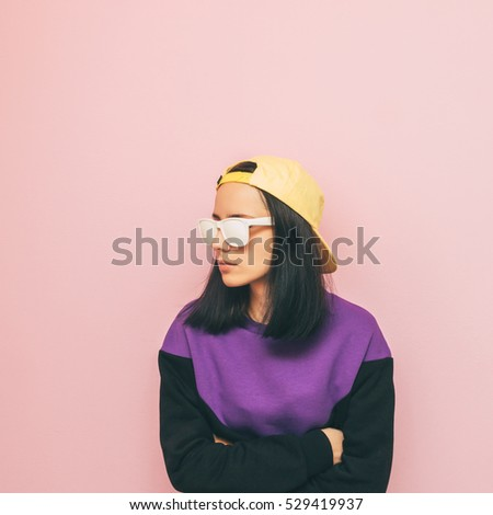 lady in a cap and sweater. the style of the 90's. winter fashion. new collection. minimalism.