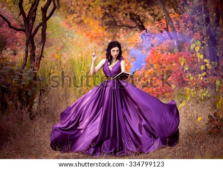 Lady in a luxury lush purple dress swirls in the smoke,fantastic shot,fairytale princess is walking in the autumn forest,fashionable toning,creative computer colors