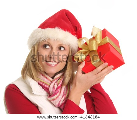 Lady in a Santa hat guessing her Christmas gift. - stock photo