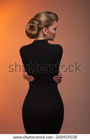 Lady in black with a beautiful laying on a beautiful background