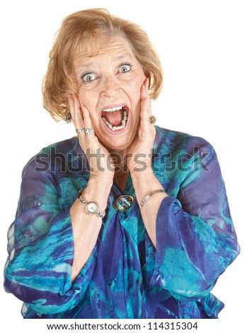 Lady in blue and hands on face screaming - stock photo