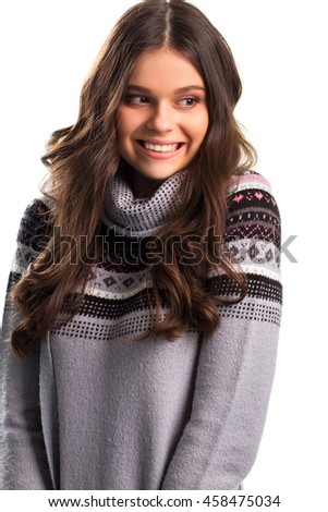 Lady in pullover widely smiles. Pink and black pattern. Happy with the presents. Mood is better than ever. - stock photo