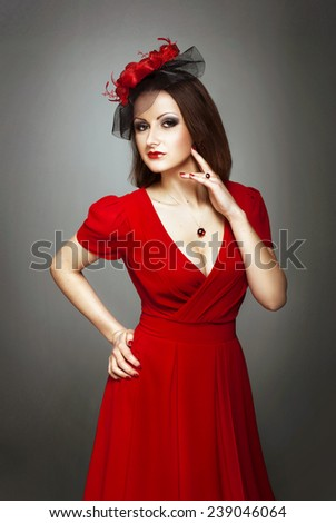Lady in red dress and  black veil on the dark background. Old fashioned. - stock photo