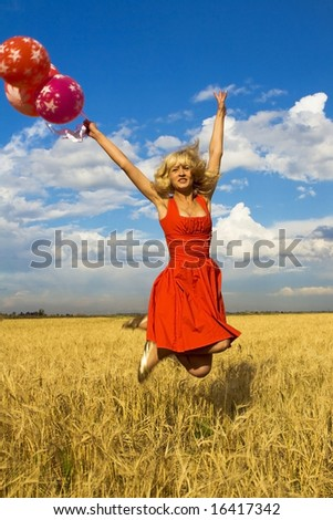 lady in red jumping with balloons