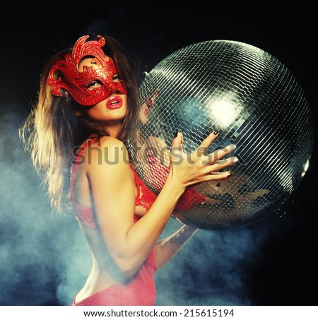 lady in red mask with disco ball - stock photo