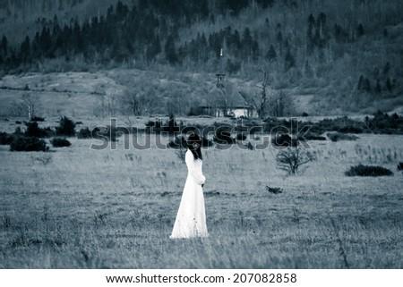 Lady in white dress - horror scene, vintage filter - stock photo