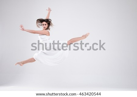 Lady in white sexy girl in a white dress, a girl on a light background, brunette in a white dress Portrait of girl in white clothes,