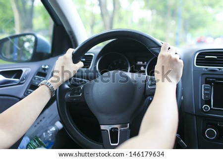 lady is learning drive a car catch steering wheel - stock photo