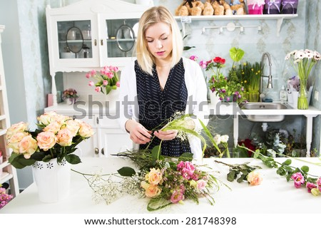 Lady is thinking through about her boquet - stock photo