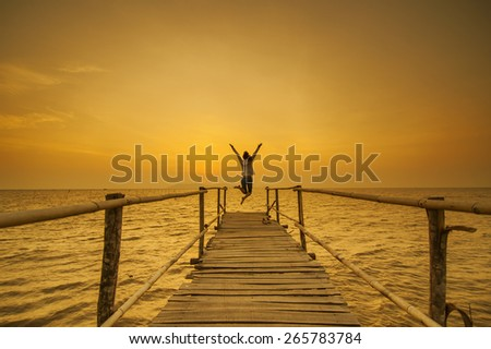Lady jumping in sunrise at Can Gio, Ho Chi Minh City ( Saigon ), Vietnam - stock photo