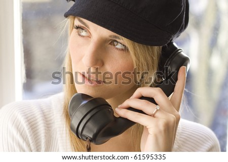 Lady listening on old telephone - stock photo