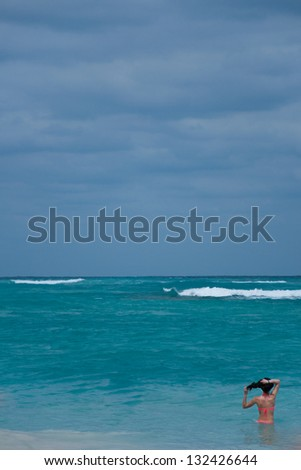 Lady Looking at the Ocean, Punta Cana, Dominican Republic - stock photo