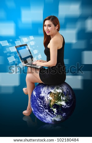 Lady on globe and Digital window icon from notebook computer : Elements of this image furnished by NASA - stock photo