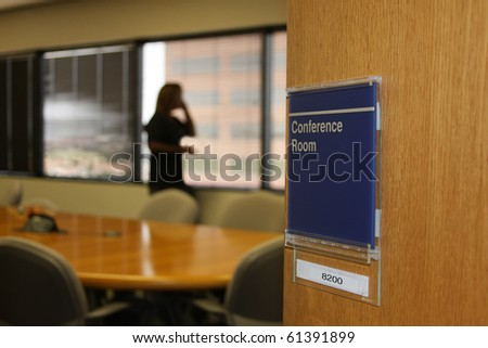 lady on phone in conference room at corporate office - stock photo
