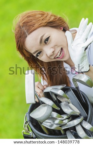 lady playing golf with lelax time - stock photo