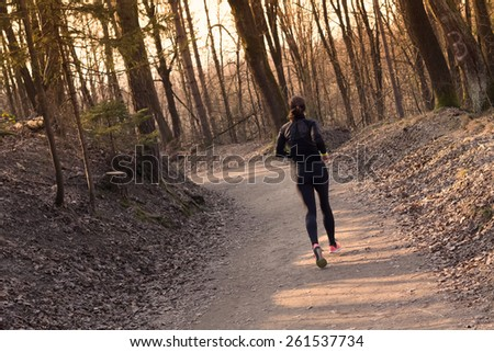 Lady running in the forest.  Running woman. Female runner jogging during outdoor workout in a Nature. Fitness model outdoors. Weight Loss. Healthy lifestyle.  - stock photo