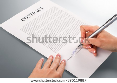Lady's hand signing promotion contract. Female hand signs promotion contract. We will help you. Companies should help each other.