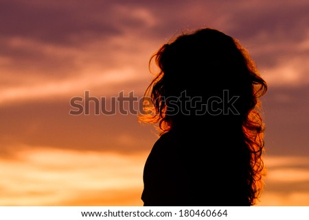 lady silhouette at sunset