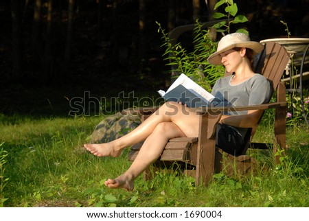 lady sitting in chair - stock photo