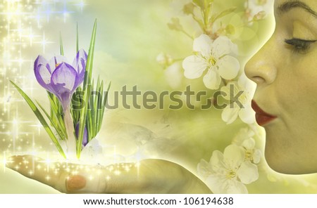 lady spring , woman in fairy style blowing on winter crocus