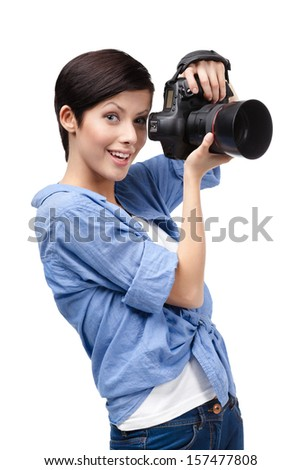 Lady takes photos holding photographic camera, isolated on white - stock photo
