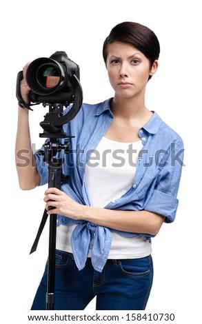Lady takes snaps holding photographic camera, isolated on white - stock photo