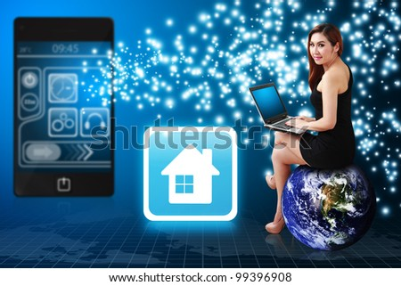 Lady use notebook computer and house icon from mobile phone : Elements of this image furnished by NASA - stock photo