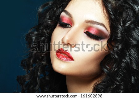 Lady Vamp Styled make up. Beautiful teen fashion model close-up Portrait
