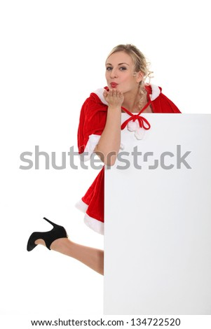lady wearing a Christmas costume and blowing a kiss - stock photo