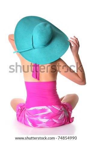 Lady wearing a pink swimnsuit and a turquoise sun hat, studio isolated on white. - stock photo