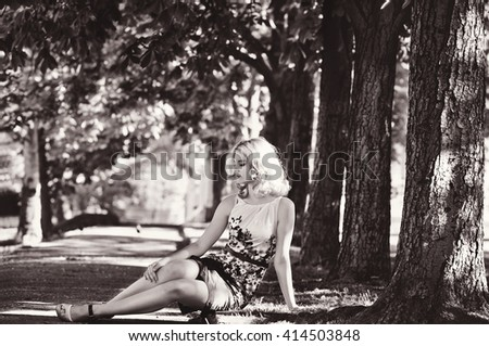 lady wearing dress sitting in the park