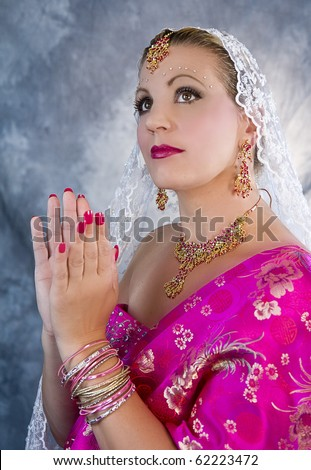 Lady wearing India sari and their ornate beautiful jewelry