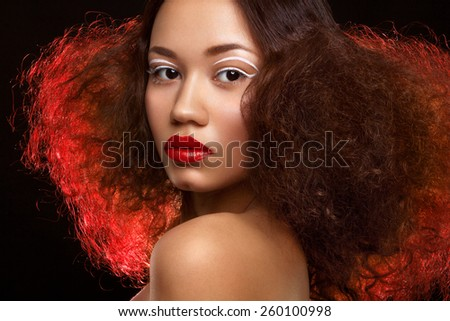 Lady with beautiful hairstyle and unusual makeup - stock photo