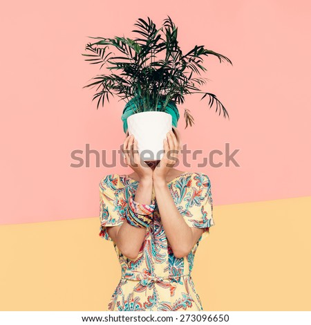 Lady with flower in trendy Summer Dress. Beach style. Turkish cucumber, summer, vacation - stock photo