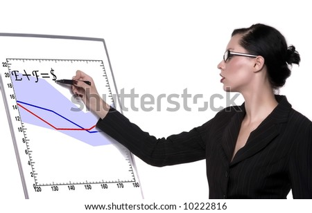 lady with glasses writes on board - stock photo