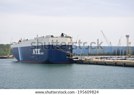 Laem Chabang - SEPTEMBER 12 : NYK RoRo ship bearthing for loading car at Laem Chabang harbour in Thailand, on September 12, 2013 - stock photo