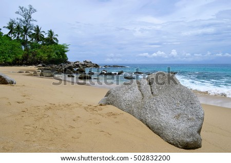 Laem Sing Beach with a rock in the foreground on the island of Phuket