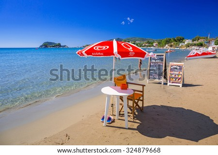 LAGANAS, GREECE - AUG 21, 2015: Ice cream shop on thebeach of Laganas on Zakynthos island, Greece. Laganas is a very popular holidays destination full of nightclubs, bars and restaurants.