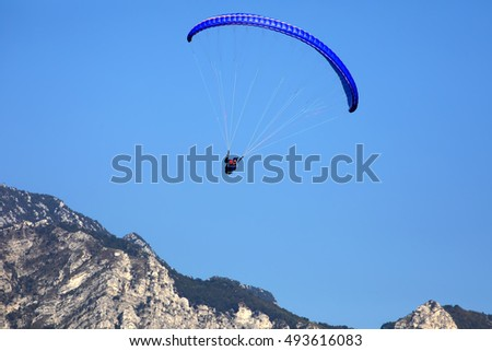 LAGO DI GARDA, ITALY  SEPTEMBER 25.2016 popular paragliding above a lake,  September 25. 2016, Lago di Garda, Italy