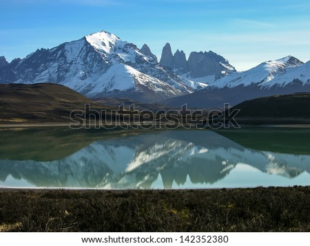 Lago Grey in the Torres del Paine national Park, Patagonia, Chile. A rare view on a calm morning. - stock photo
