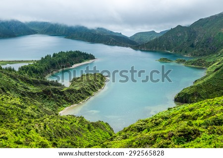 Lagoa do Fogo, a volcanic lake in Sao Miguel, Azores under the dramatic clouds - stock photo