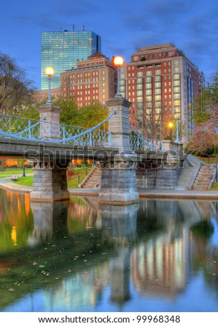 Lagoon Bridge and skyline of Boston, Massachusetts fromthe Boston Public Gardens. - stock photo