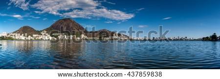 Lagoon Rodrigo de Freitas and Ipanema neighborhood skyline in Rio de Janeiro, Brazil - stock photo