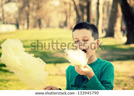 Lagre sugarwool bite taken by a young boy in a park