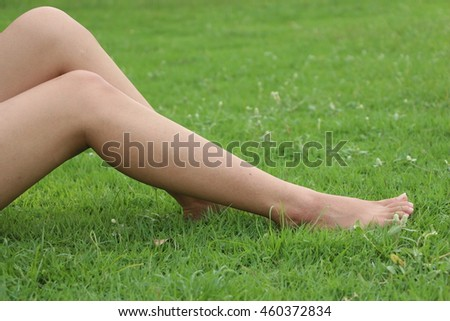 Lags woman on grass.Woman alone in park